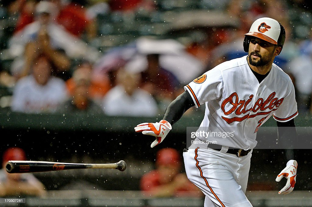 <a gi-track='captionPersonalityLinkClicked' href=/galleries/search?phrase=Nick+Markakis&family=editorial&specificpeople=614708 ng-click='$event.stopPropagation()'>Nick Markakis</a> #21 of the Baltimore Orioles is walked in the fourth inning against the Los Angeles Angels of Anaheim at Oriole Park at Camden Yards on June 10, 2013 in Baltimore, Maryland.