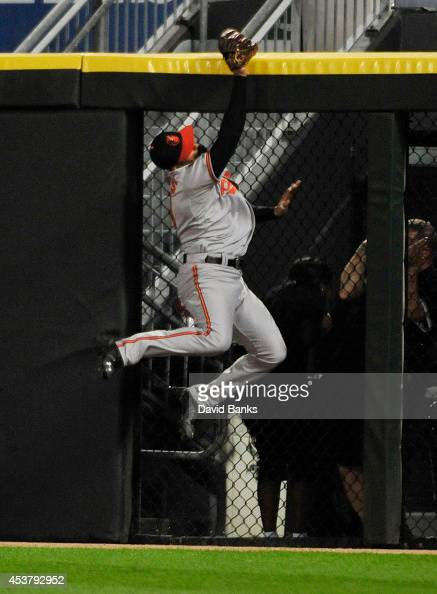 Nick Markakis of the Baltimore Orioles makes a catch on Conor Gillaspie of the Chicago White Sox during the seventh inning on August 18 2014 at U S...