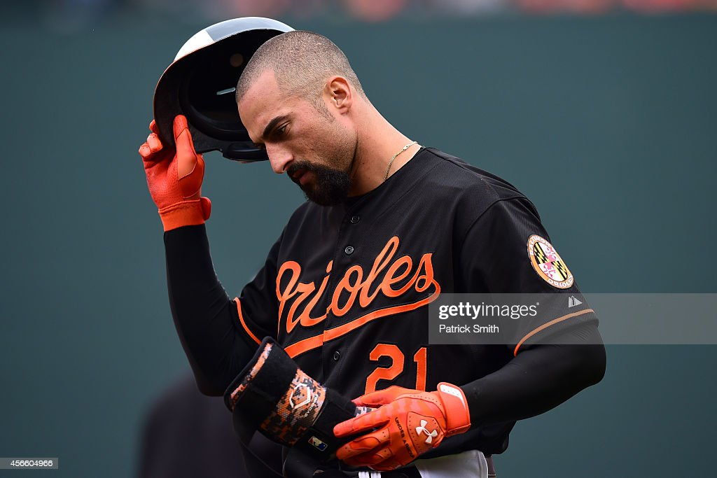 Nick Markakis of the Baltimore Orioles reacts after grounding out in the seventh inning against the Detroit Tigers during Game Two of the American...