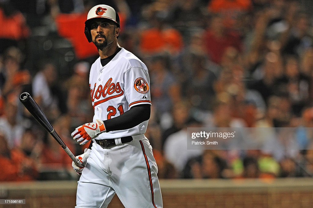 <a gi-track='captionPersonalityLinkClicked' href=/galleries/search?phrase=Nick+Markakis&family=editorial&specificpeople=614708 ng-click='$event.stopPropagation()'>Nick Markakis</a> #21 of the Baltimore Orioles reacts after striking out in the seventh inning at Oriole Park at Camden Yards on June 26, 2013 in Baltimore, Maryland. The Cleveland Indians won, 4-3.