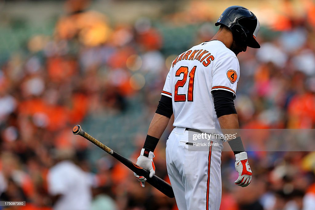 <a gi-track='captionPersonalityLinkClicked' href=/galleries/search?phrase=Nick+Markakis&family=editorial&specificpeople=614708 ng-click='$event.stopPropagation()'>Nick Markakis</a> #21 of the Baltimore Orioles reacts after striking out in the first inning against the Houston Astros at Oriole Park at Camden Yards on July 31, 2013 in Baltimore, Maryland.