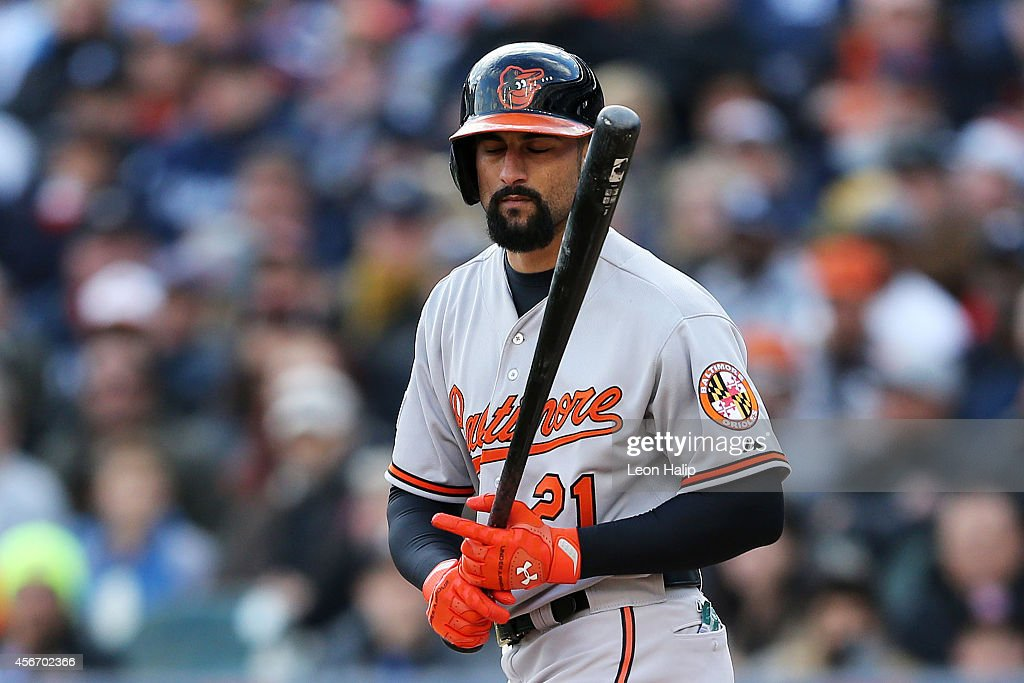 Nick Markakis of the Baltimore Orioles reacts as he strikes out to end the top of the fifth inning against the Detroit Tigers during Game Three of...