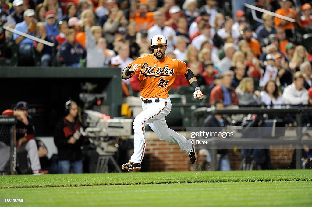Nick Markakis #21 of the Baltimore Orioles runs the bases against the Boston Red Sox at Oriole Park at Camden Yards on September 28, 2013 in Baltimore, Maryland.