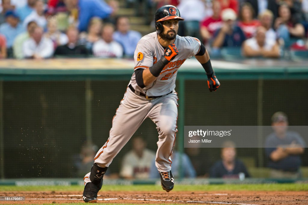 Nick Markakis #21 of the Baltimore Orioles runs to first base during the second inning against the Cleveland Indians at Progressive Field on September 4, 2013 in Cleveland, Ohio.