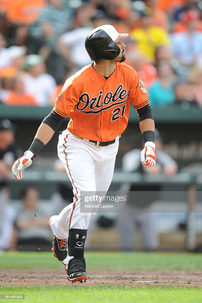 Nick Markakis #21 of the Baltimore Orioles takes a swing during a baseball game against the Chicago White Sox on September 7, 2013 at Oriole Park at Camden Yards in Baltimore, Maryland. The Orioles won 4-3 in the tenth inning.