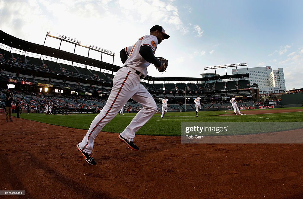 <a gi-track='captionPersonalityLinkClicked' href=/galleries/search?phrase=Nick+Markakis&family=editorial&specificpeople=614708 ng-click='$event.stopPropagation()'>Nick Markakis</a> #21 of the Baltimore Orioles takes the field before the start of the Orioles game against the Tampa Bay Rays at Oriole Park at Camden Yards on April 18, 2013 in Baltimore, Maryland.