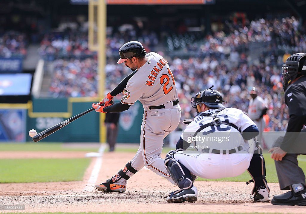 Nick Markakis #21 of the Baltimore Orioles triples to deep right field in the eighth inning of the game against the Detroit Tigers at Comerica Park on April 6, 2014 in Detroit, Michigan. The Orioles defeated the Tigers 3-1.