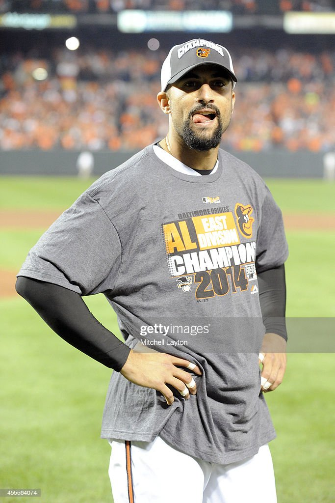Nick Markakis #21 of the Baltimore Orioles watches his team celebrate on the field after the Orioles clinch the American League East Division during a baseball game against the Toronto Blue Jays on September 16, 2014 at Oriole Park at Camden Yards in Baltimore, Maryland.