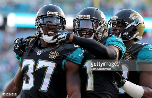 Nick Marshall and Johnathan Cyprien of the Jacksonville Jaguars celebrate an interception return during the game against the Indianapolis Colts at...