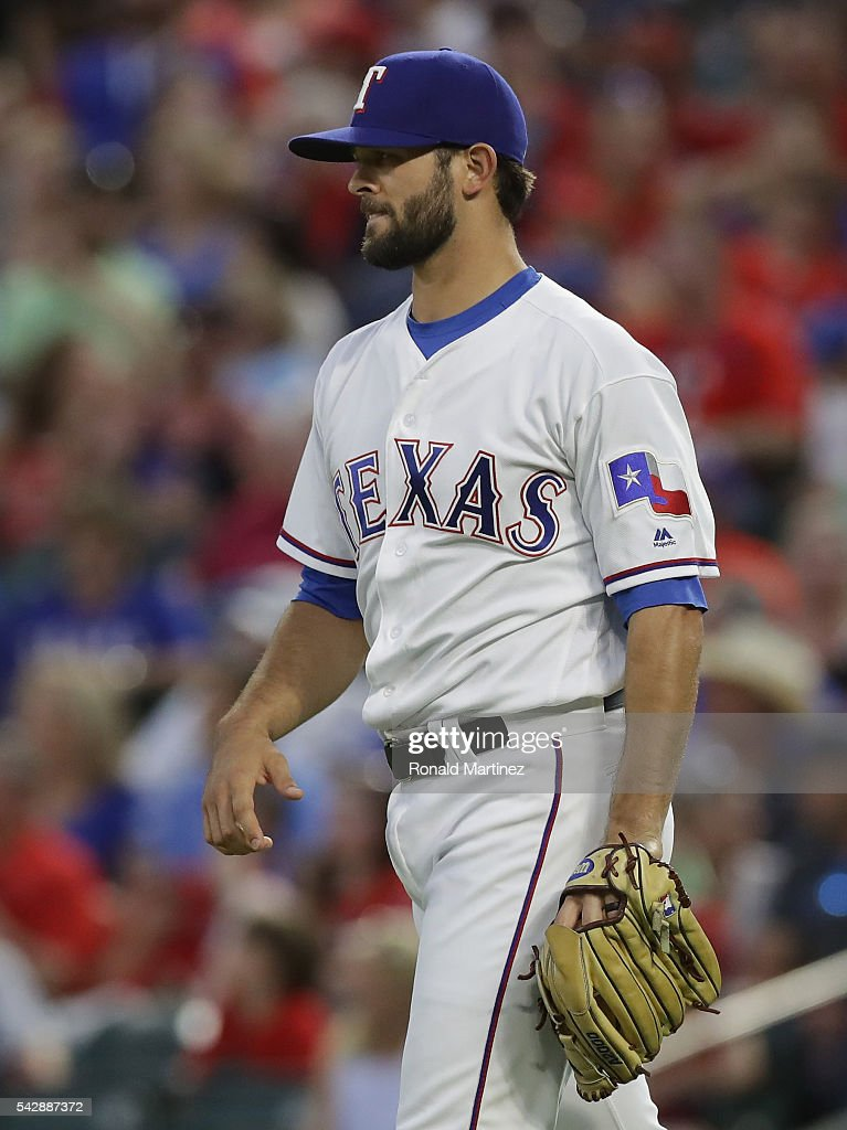 Nick Martinez #22 of the Texas Rangers steps off the mound after giving up a two-run homerun against Hanley Ramirez #13 of the Boston Red Sox in the fourth inning at Globe Life Park in Arlington on June 24, 2016 in Arlington, Texas.