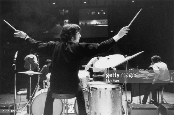 Nick Mason of British psychedelic rock group Pink Floyd signals to the crew during rehearsals at the Queen Elizabeth Hall in London 12th May 1967...
