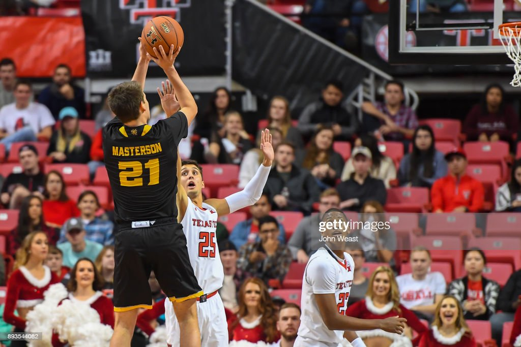 Nick Masterson #21 of the Kennesaw State Owls shoots the ball over Davide Moretti #25 of the Texas Tech Red Raiders during the game on December 13, 2017 at United Supermarkets Arena in Lubbock, Texas. Texas Tech defeated Kennesaw State 82-53.