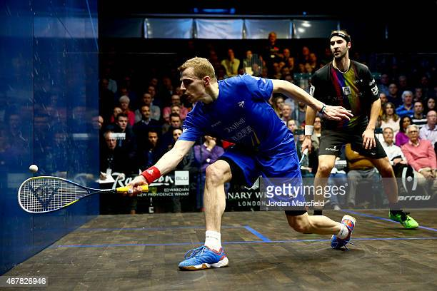 Nick Matthew of Great Britain plays a shot during the final against Simon Rosner of Germany on Day 5 of the Canary Wharf Squash Classic at the East...