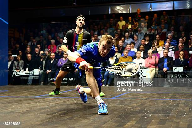 Nick Matthew of Great Britain reaches for a shot during the final against Simon Rosner of Germany on Day 5 of the Canary Wharf Squash Classic at the...
