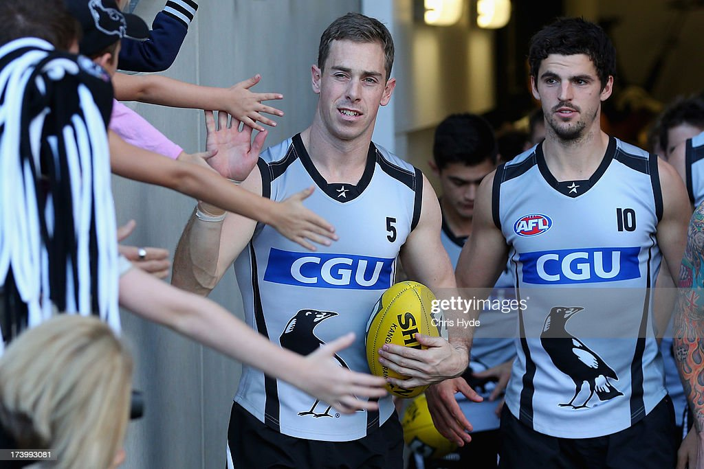 Nick Maxwell and Scott Pendlebury arrive for a Collingwood Magpies AFL training session at Metricon Stadium on July 19, 2013 in Gold Coast, Australia.