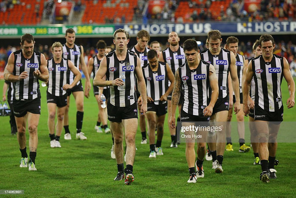 <a gi-track='captionPersonalityLinkClicked' href=/galleries/search?phrase=Nick+Maxwell&family=editorial&specificpeople=596853 ng-click='$event.stopPropagation()'>Nick Maxwell</a> of the Magpies leads the team off after losing the round 17 AFL match between the Gold Coast Suns and the Collingwood Magpies at Metricon Stadium on July 20, 2013 in Gold Coast, Australia.