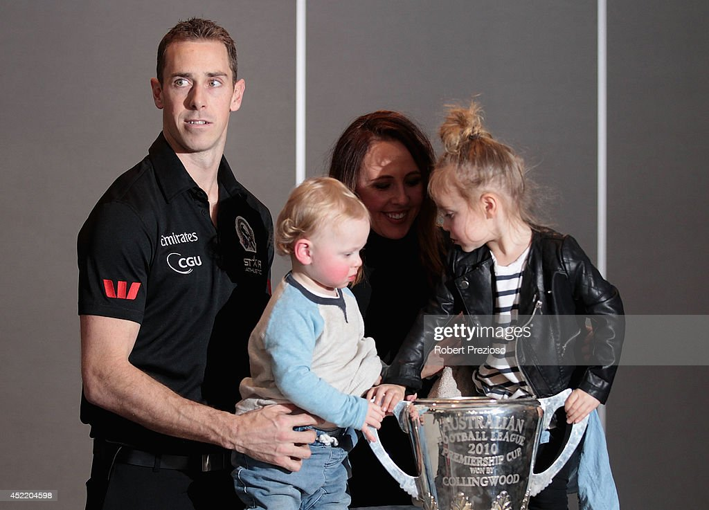 Nick Maxwell poses with his family after speaking to the media, announcing his retirement, during a Collingwood Magpies AFL press conference at the Westpac Centre on July 16, 2014 in Melbourne, Australia.