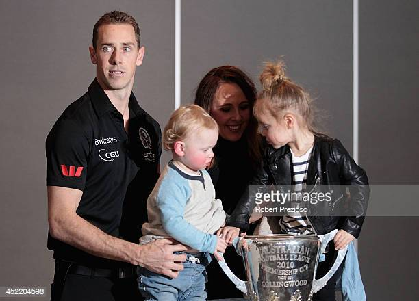 Nick Maxwell poses with his family after speaking to the media announcing his retirement during a Collingwood Magpies AFL press conference at the...