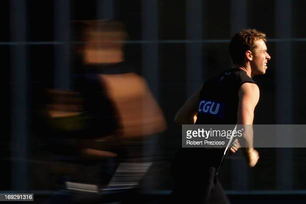 Nick Maxwell runs with teammates during a Collingwood Magpies AFL training session at Olympic Park on May 23 2013 in Melbourne Australia
