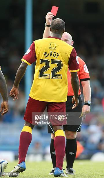 Nick McKoy of Northampton Town is shown a red card by referee Simon Hooper during the npower League Two match between Southend United and Northampton...