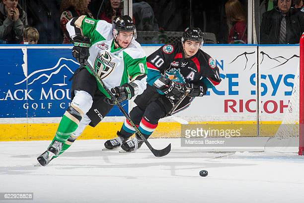 Nick Merkley of the Kelowna Rockets back checks Vojtech Budik of the Prince Albert Raiders as he skates behind the net with the puck during first...