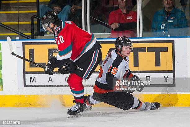 Nick Merkley of the Kelowna Rockets checks Ty Schultz of the Medicine Hat Tigers at the boards at Prospera Place on November 5 2016 in Kelowna Canada