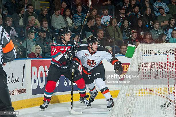 Nick Merkley of the Kelowna Rockets is checked by the Medicine Hat Tigers during second period at Prospera Place on November 5 2016 in Kelowna Canada