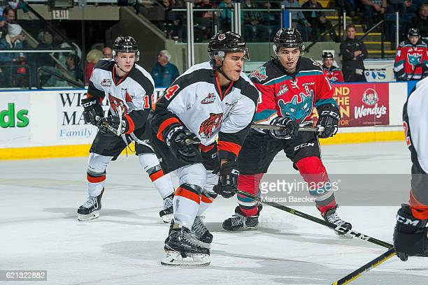 Nick Merkley of the Kelowna Rockets stick checks Clayton Kirichenko of the Medicine Hat Tigers during second period at Prospera Place on November 5...