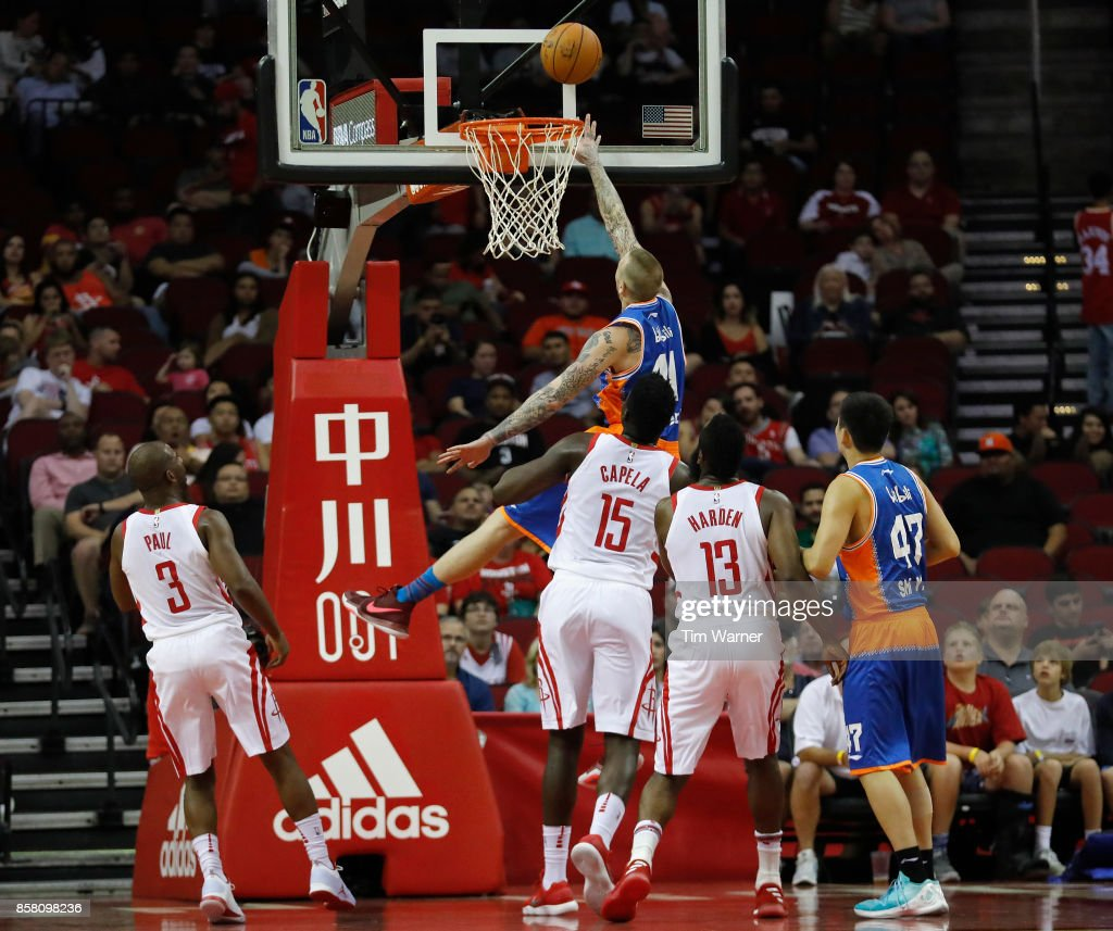 Nick Minnerath #41 of Shanghai Sharks shoots a lay up defended by Clint Capela #15 of Houston Rockets in the first half at Toyota Center on October 5, 2017 in Houston, Texas.