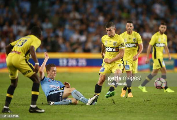 Nick Montgomery of the Mariners and Brandon O'Neill of Sydney FC compete for the ball during the round 23 ALeague match between Sydney FC and the...