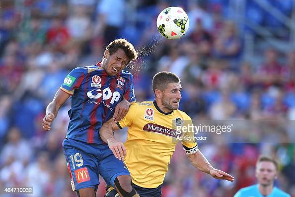 Nick Montgomery of the Mariners contests the header against Mitch Cooper of the Jets during the round 19 ALeague match between the Newcastle Jets and...