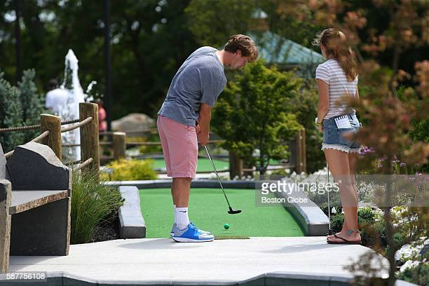 Nick Moore and Sarah Pokelwaldt try the new mini golf course at Nunans July 30 2016 Nunan Florist and Greenhouses opened an 18hole miniature golf...