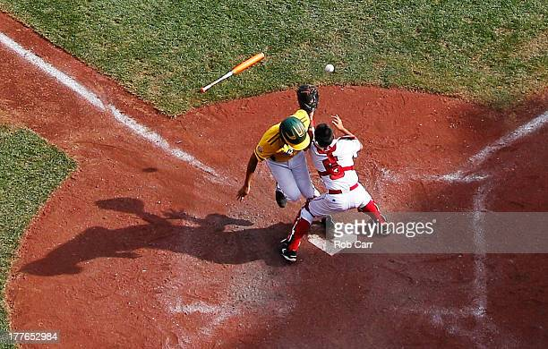Nick Mora of the West team from Chula Vista Ca scores a run in the fourth inning as catcher Ryusei Hirooka of the Tokyo Japan team waits for the tag...
