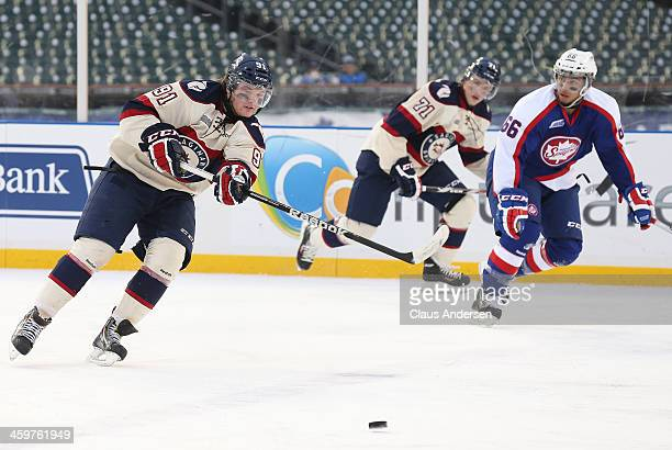 Nick Moutrey of the Saginaw Spirit makes a pass against the Windsor Spitfires during Game One of the OHL Winter Classic at Comerica Park on December...