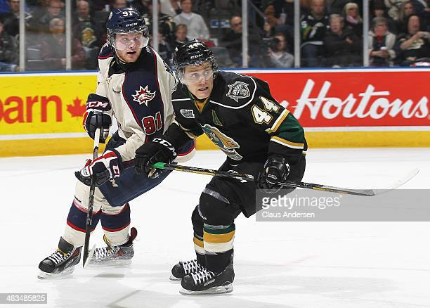 Nick Moutrey of the Saginaw Spirit skates against Dakota Mermis of the London Knights during an OHL game at the Budweiser Gardens on January 17 2014...
