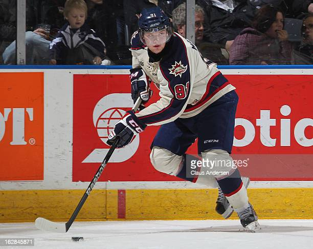 Nick Moutrey of the Saginaw Spirit skates with the puck in an OHL game against the London Knights on February 24 2013 at the Budweiser Gardens in...