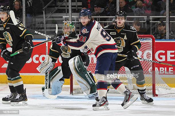 Nick Moutrey of the Saginaw Spirit waits for a shot to tip in an OHL game against the London Knights on February 24 2013 at the Budweiser Gardens in...