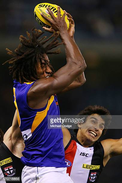 Nick Naitanui of the Eagles marks the ball against Trent DennisLane of the Saints during the round 11 AFL match between the St Kilda Saints and the...
