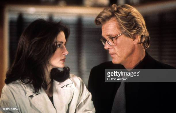 Nick Nolte and Julia Roberts staring at one an other in a scene from the film 'I Love Trouble' 1994