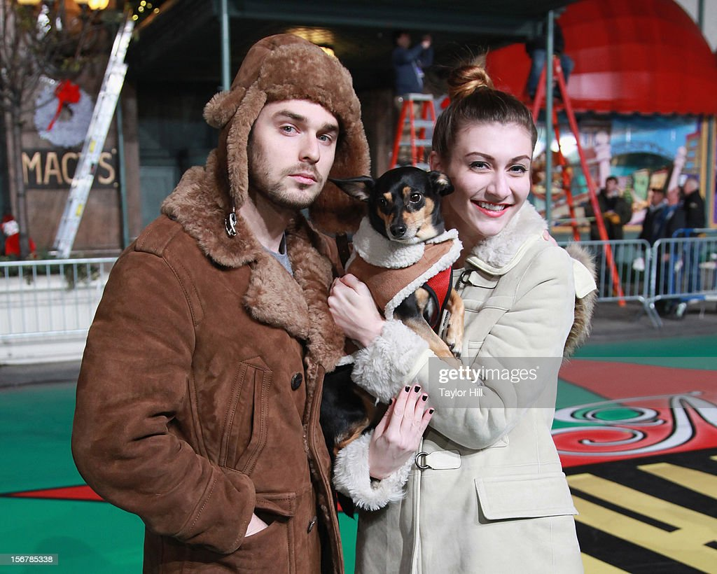 Nick Noonan and Amy Heidemann of Karmin pose with a puppy named Max during day two of the 86th Anniversary Macy's Thanksgiving Day Parade Rehearsals at Macy's Herald Square on November 20, 2012 in New York City.