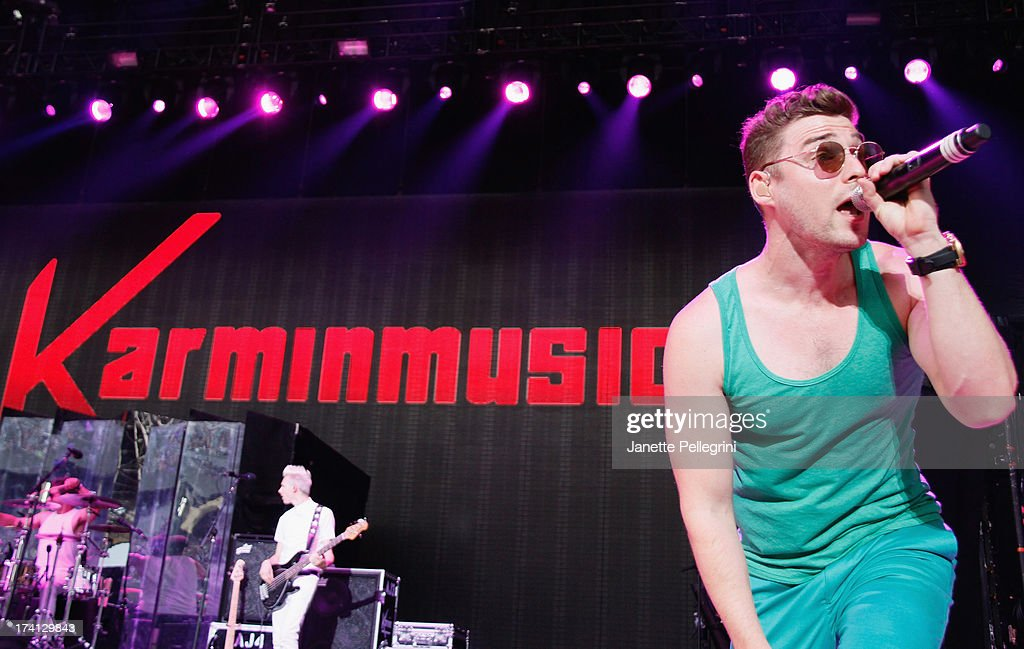 Nick Noonan of Karmin perfoms at Nikon at Jones Beach Theater on July 20, 2013 in Wantagh, New York.