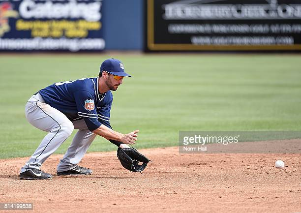 Nick Noonan of the San Diego Padres makes a play on a ground ball against the Milwaukee Brewers during the second inning of a spring training game at...
