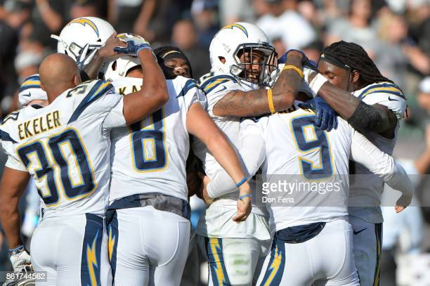 Nick Novak of the Los Angeles Chargers celebrates with teammates after kicking the game winning field goal as time expires in their NFL game against...