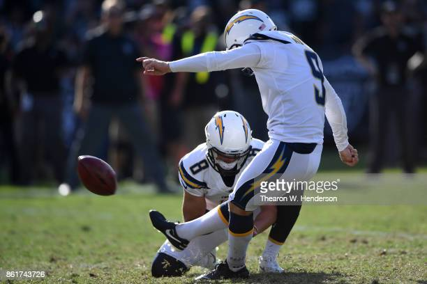 Nick Novak of the Los Angeles Chargers kicks the game winning field goal as time expires in their NFL game against the Oakland Raiders at...