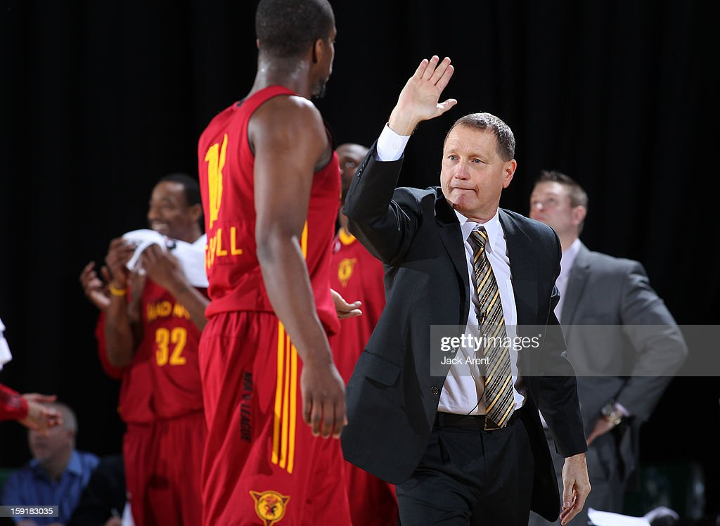 Nick Nurse Head Coach of the Fort Wayne Mad Ants high-fives Tony Mitchell #18 while playing against the Rio Grande Valley Vipers during the 2013 NBA D-League Showcase on January 9, 2013 at the Reno Events Center in Reno, Nevada.
