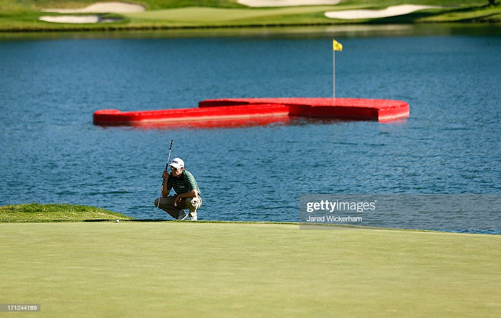 Nick O'Hern of Australia lines up his putt on the 17th green during the final round of the 2013 Travelers Championship at TPC River Highlands on June...