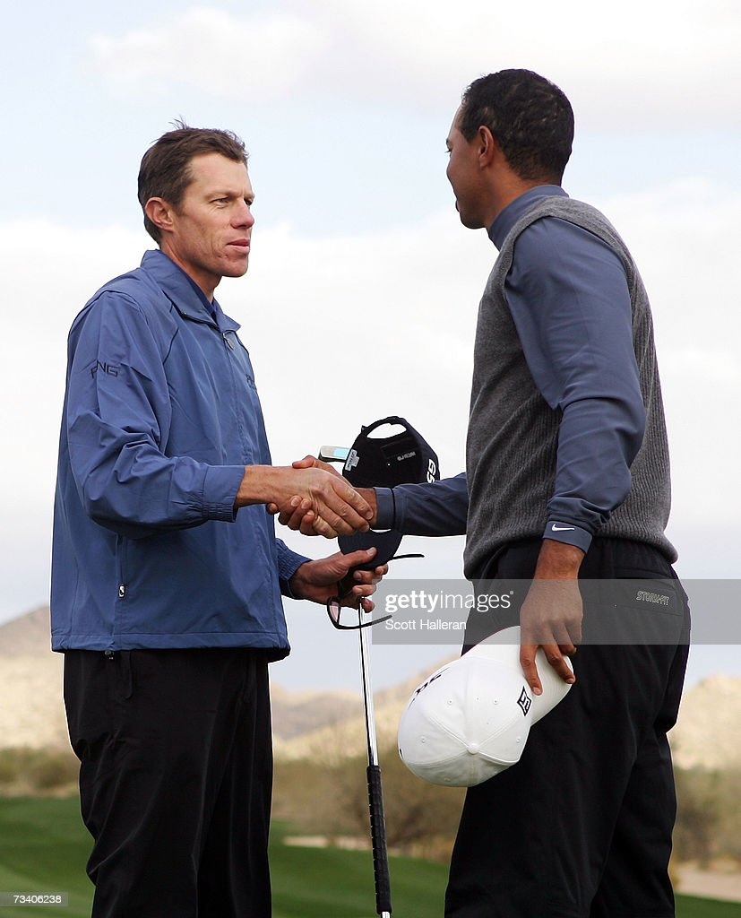 Nick O'Hern of Australia shakes hands with Tiger Woods after defeating Woods on the 20th hole during the third round of the WGCAccenture Match Play...