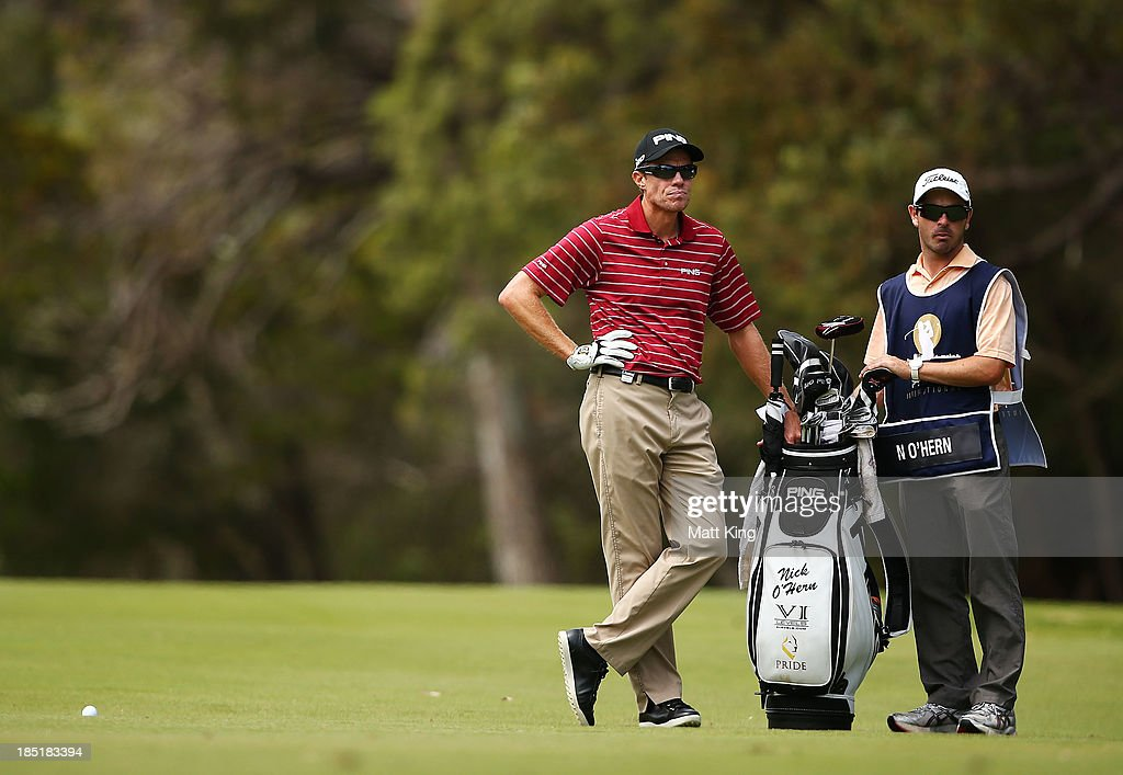 Nick O'Hern of Australia waits with his caddie to play his fairway shot on the 4th hole during day two of the Perth International at Lake Karrinyup...