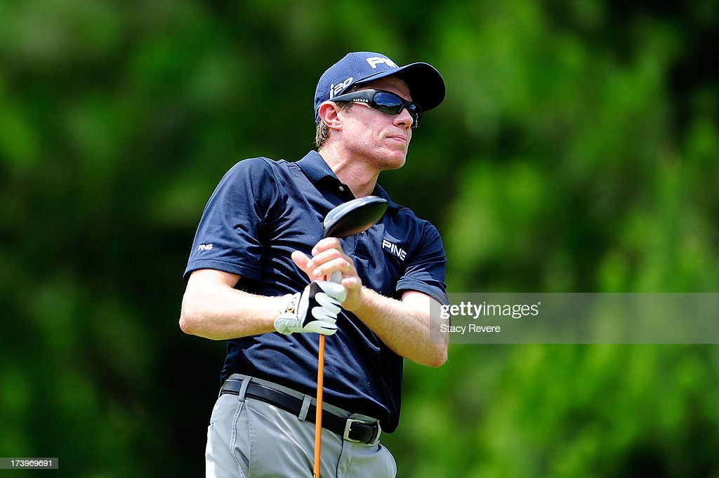 Nick O'Hern of Australia watches his tee shot on the fifth hole during the first round of the Sanderson Farms Championship at Annandale Golf Club in...