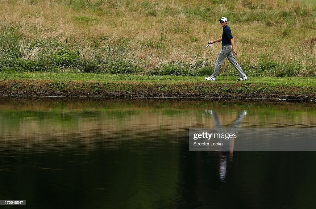 Nick O'Hern walks to find his ball on the 15th hole during the second round of the Wyndham Championship at Sedgefield Country Club on August 16 2013...